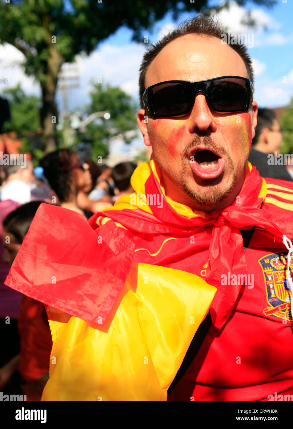 Soccer fans took to the streets of Toronto in celebration on Sunday after Spain's shutout win over Italy in - Stock Image