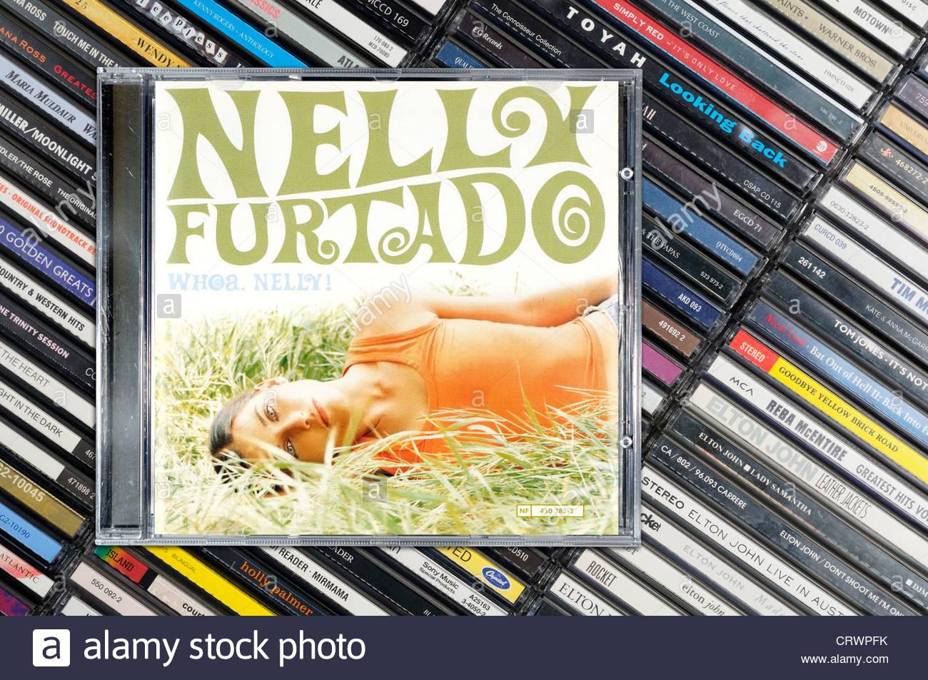 Nelly Furtado album, Whoa Nelly piled music CD cases, England. Stock Photo
