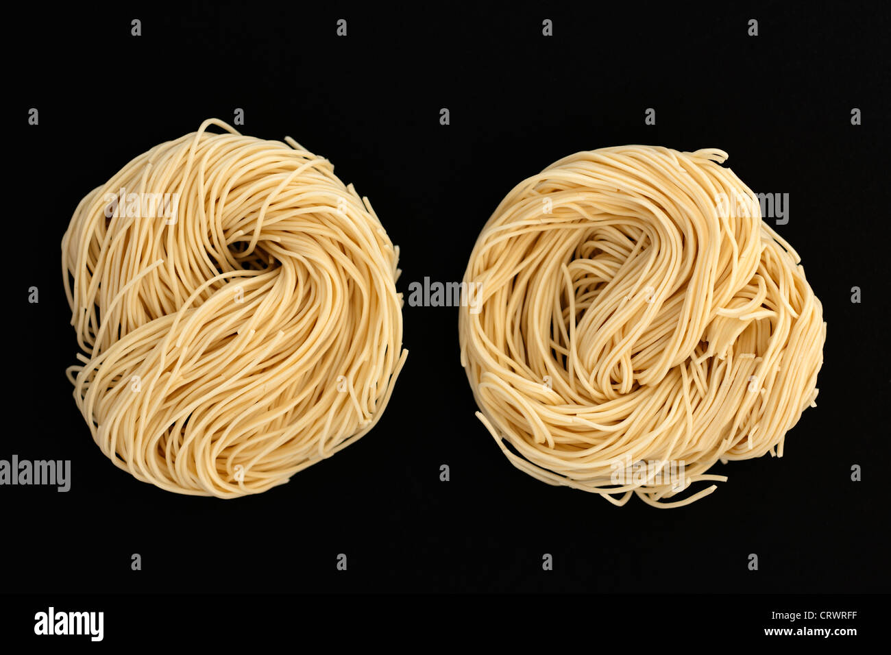 Two nests of fine egg noodles - Stock Image