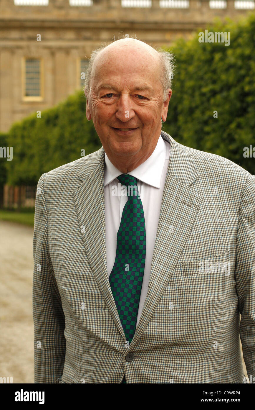 Peregrine Cavendish,12th Duke of Devonshire on South Lawn against backdrop of south facade of Chatsworth House, - Stock Image