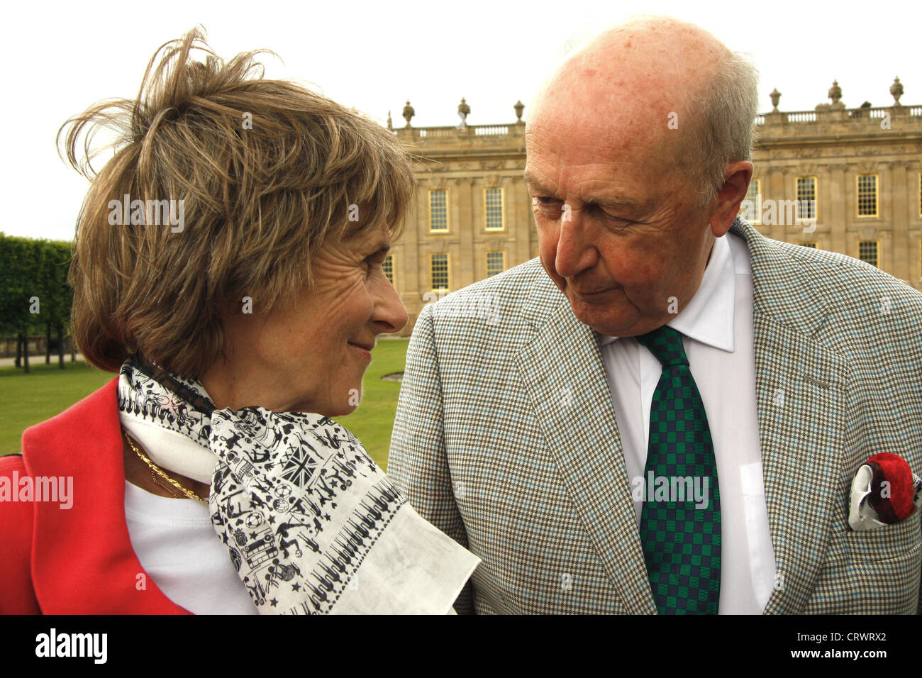 The Duke & Duchess of Devonshire share an itimate moment on the South Lawn against backdrop of Chatsworth House, - Stock Image