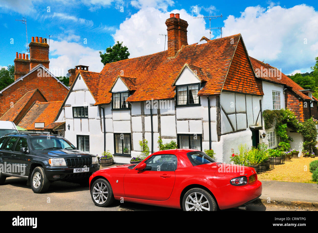 Cottages in the picturesque village of Shere in Surrey, England, UK - Stock Image