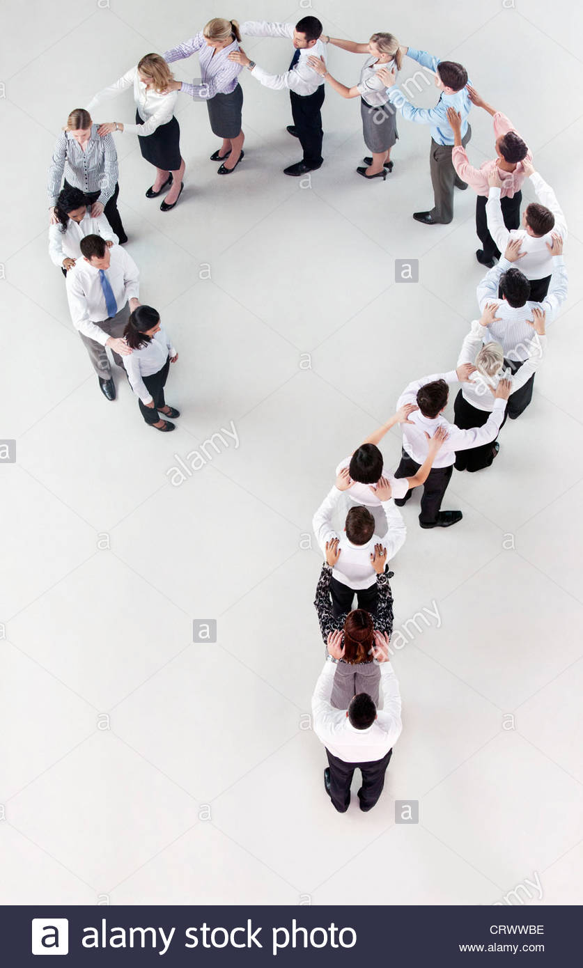 Business people forming question mark Stock Photo