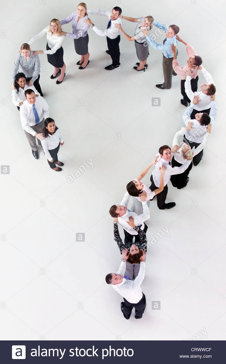 Portrait of business people forming question mark - Stock Image