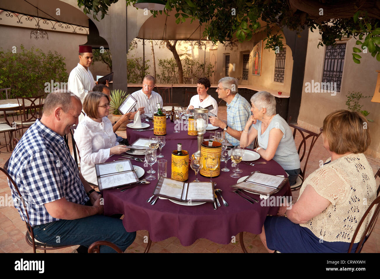 Hotel guests enjoying a meal at the Dar Zitoune Riad, Taroudant, Morocco Africa - Stock Image