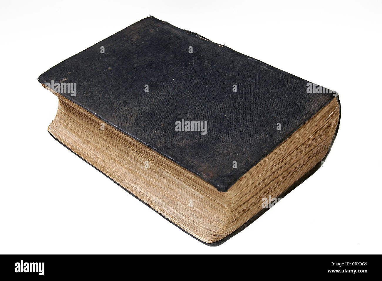 A very old closed book on white background - Stock Image