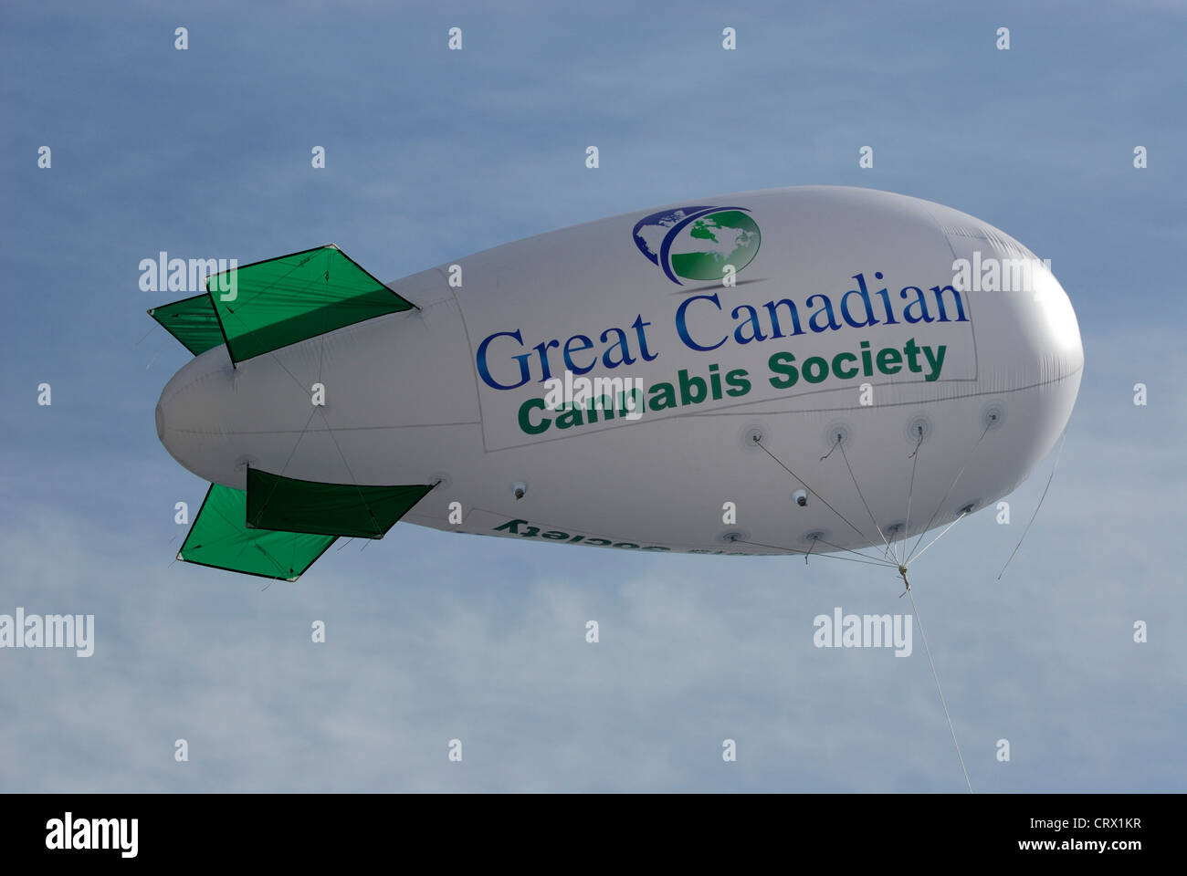 Inflatable blimp advertising cannabis and marking the spot of the 4 20 annual smoke in held in Vancouver. - Stock Image