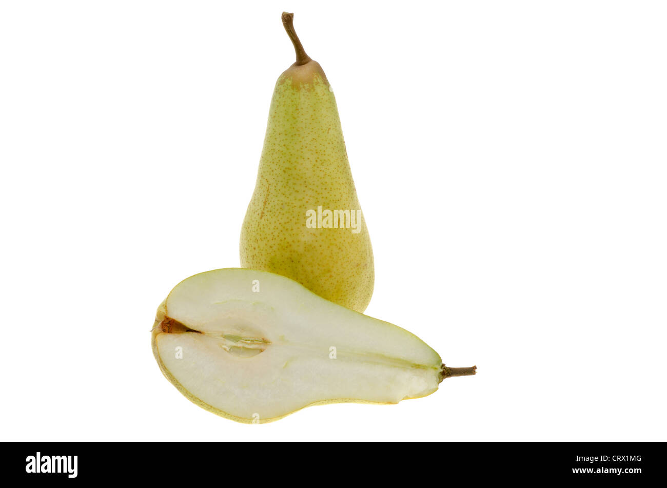Fresh whole green pear and a pear cut in half - studio shot with a white background. - Stock Image
