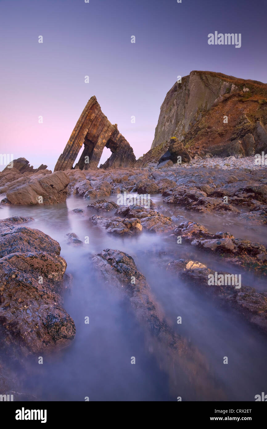 Blackchurch Rock and rocky ledges at twilight, Mouthmill Beach, North Devon, England. Winter (January) 2010. - Stock Image