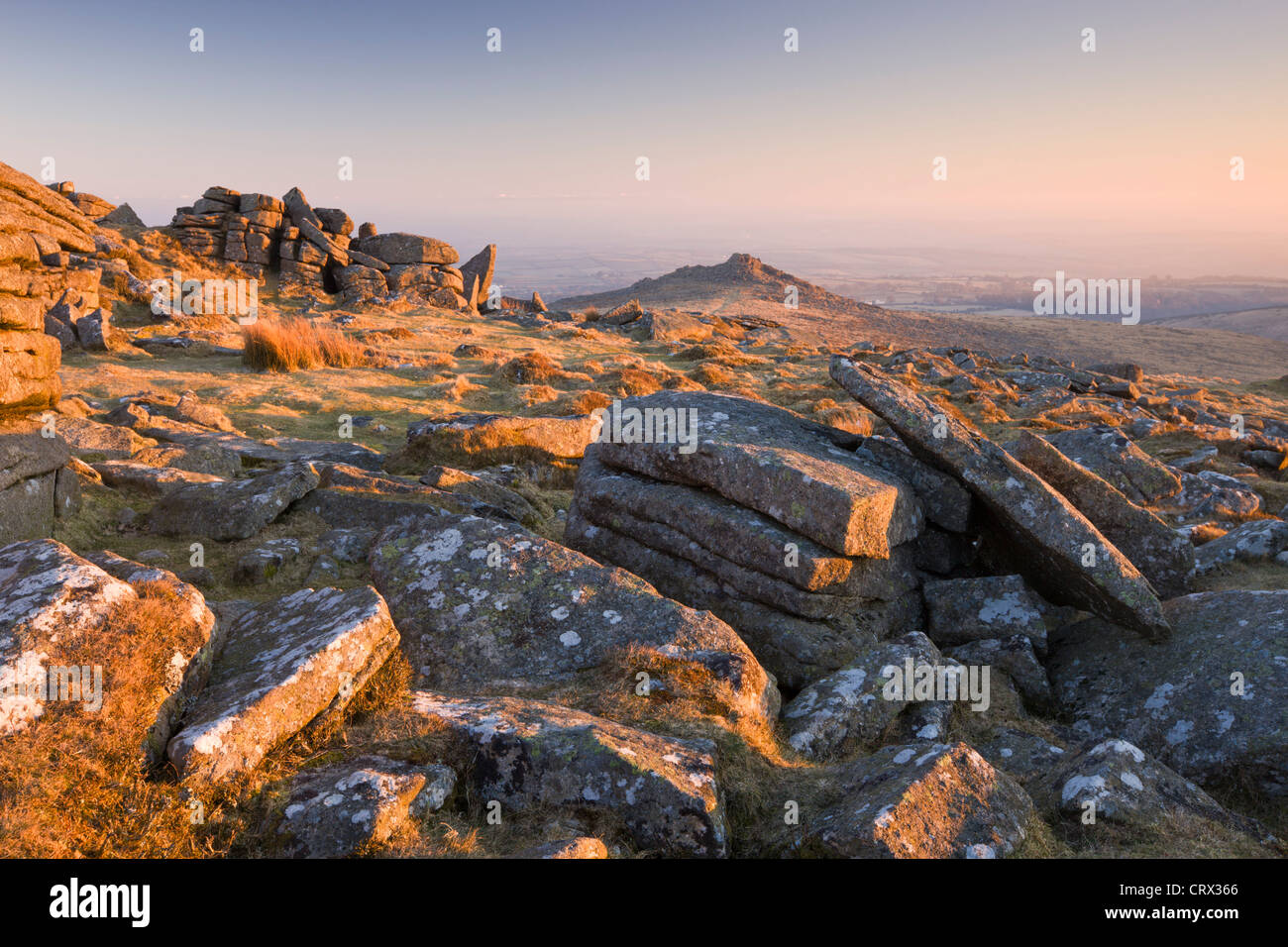 Broken granite rocks on Belstone Common at dawn, Dartmoor National Park, Devon, England. Winter (March) 2010. - Stock Image