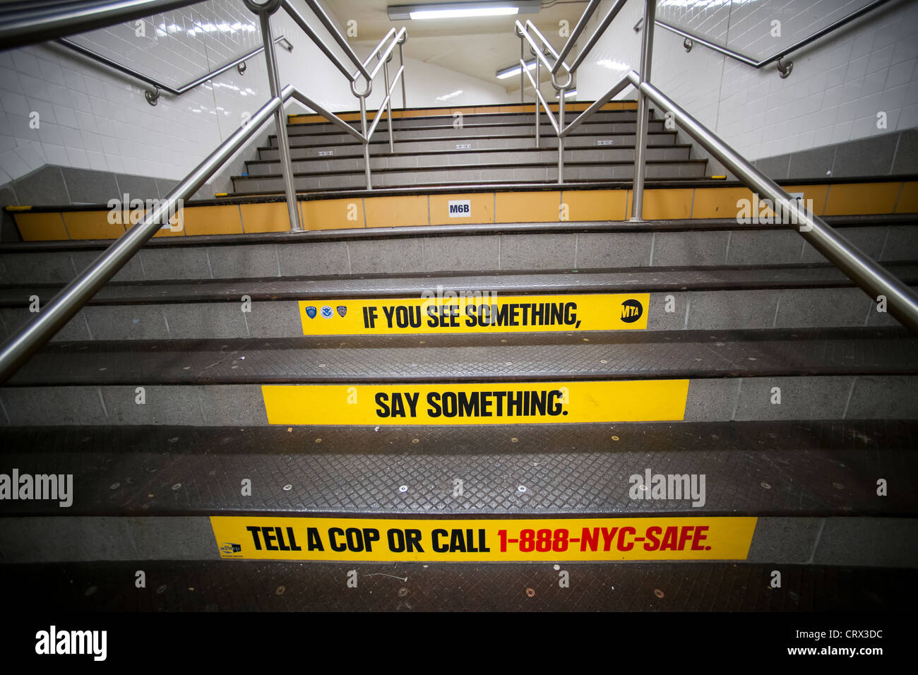'If You See Something, Say Something', decaled onto the stairs in the New York subway - Stock Image