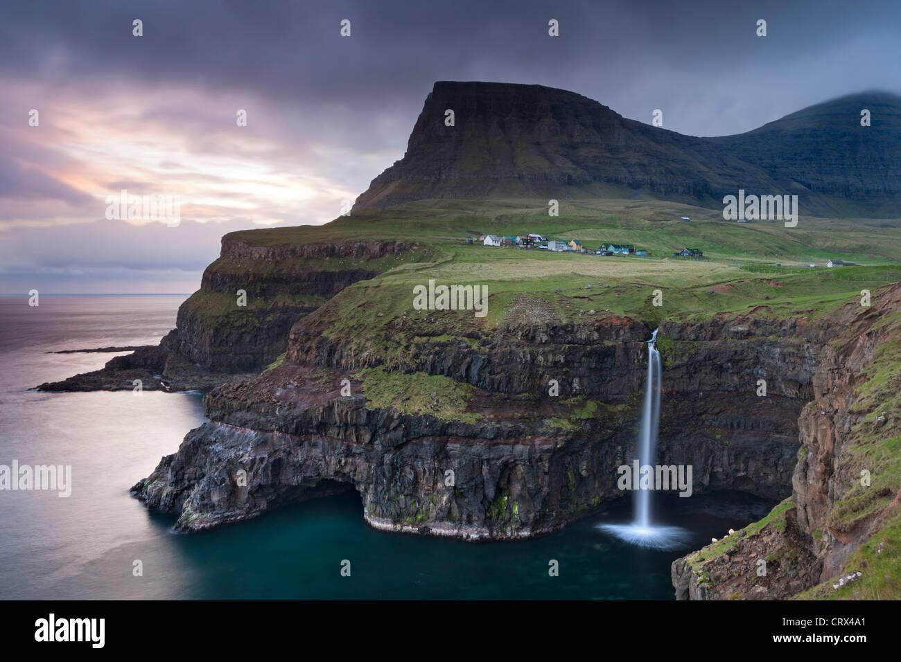 Dramatic coastal scenery at Gasadalur on the island of Vagar, Faroe Islands. Spring (May) 2012. - Stock Image