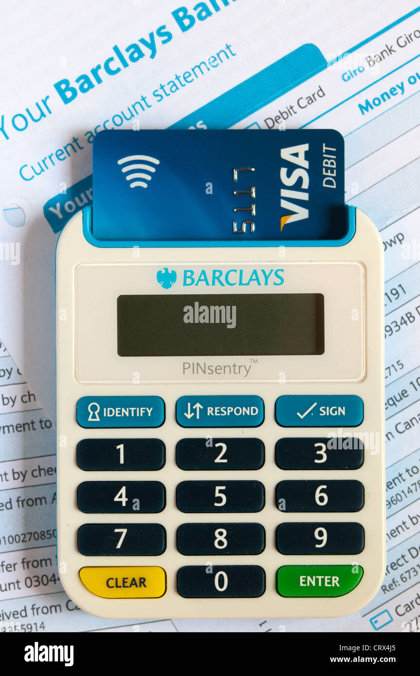 A Barclays passcode authentication PINsentry device reading a chip and pin card to verify identity. On Barclays - Stock Image