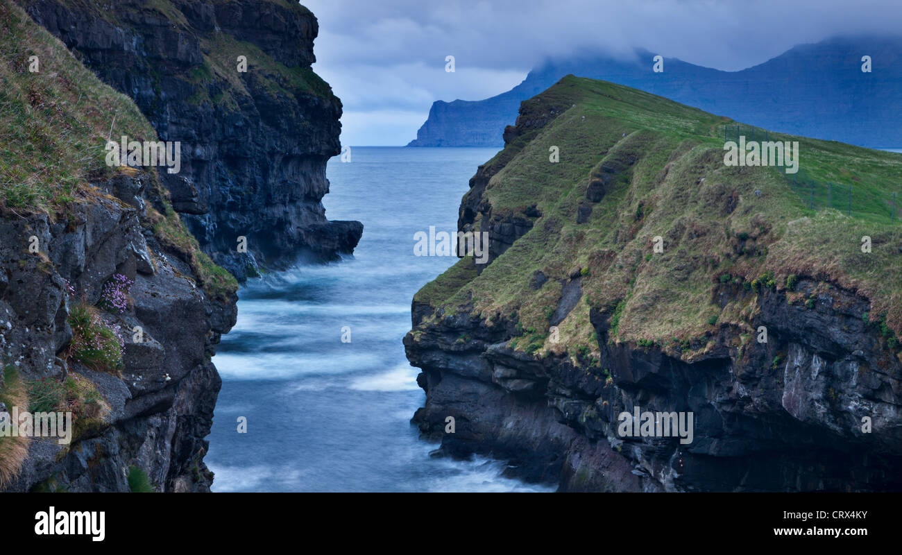 Dramatic coastline at Gjogv on the island of Eysturoy, Faroe Islands. Spring (June) 2012. - Stock Image