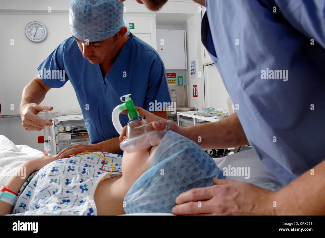 An anaesthetist administering medical gases to induce anaesthesia in a patient. - Stock Image