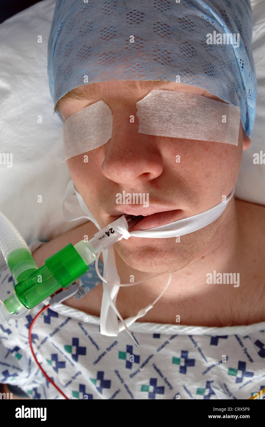 Close up of the face of an anesthetized male patient. - Stock Image