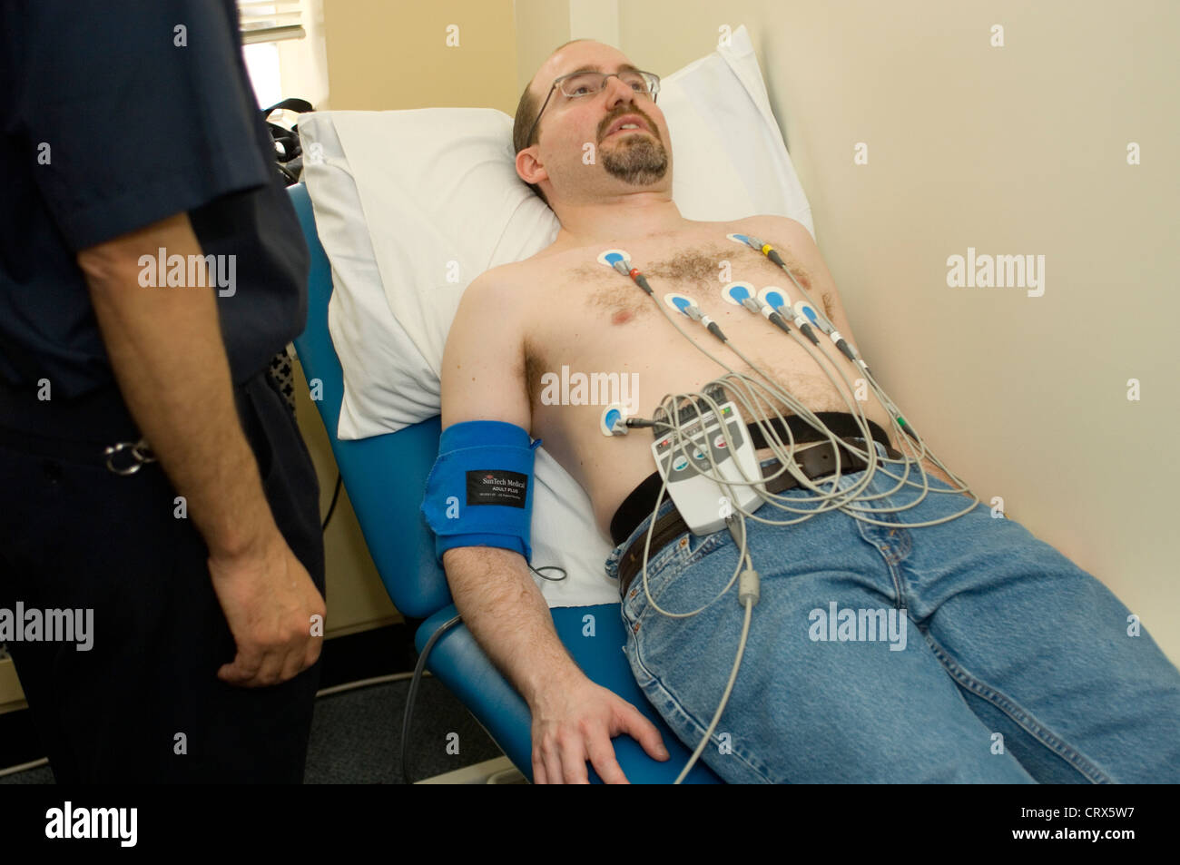 Electrocardiogram Man Stock Photos Ekg Wiring Diagram A Wired Up To Undergo An Evaluate His Cardiac Function And Diagnose