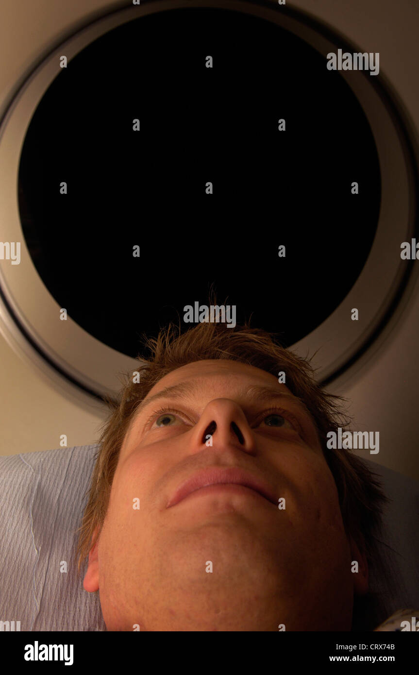 A man having a CAT scan. - Stock Image