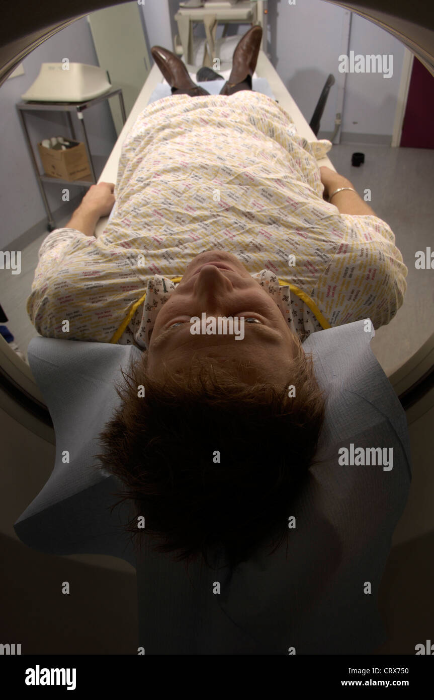 A young man having a CAT scan - Stock Image