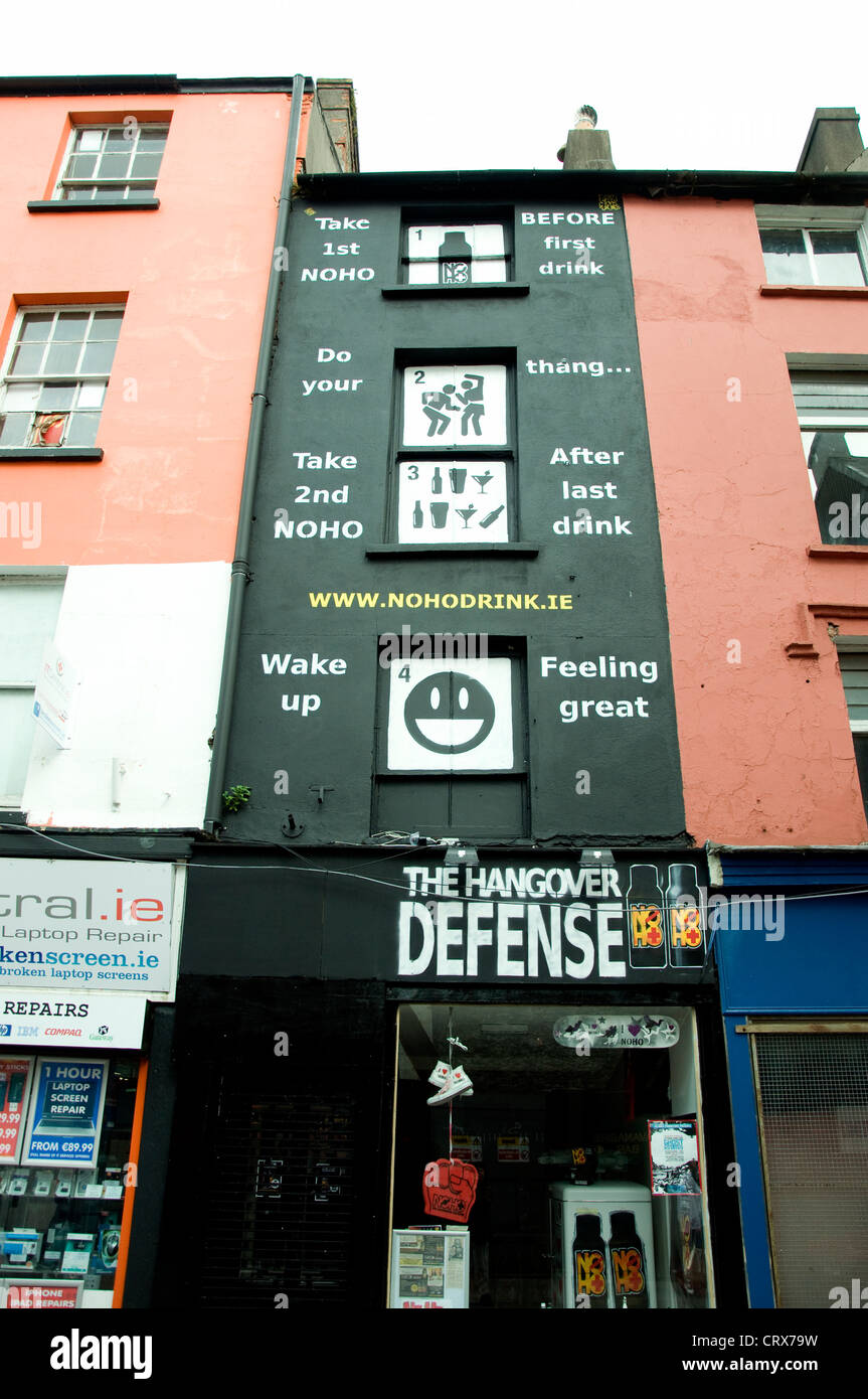 Building in Cork city, Ireland, its entire façade promoting a hangover cure - Stock Image