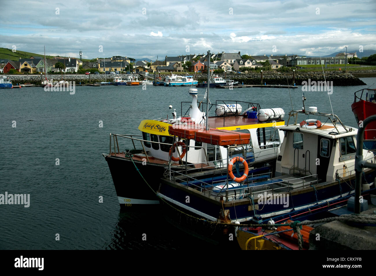 Dingle harbour with boats; the town is a popular resort in Co.Kerry, Ireland - Stock Image