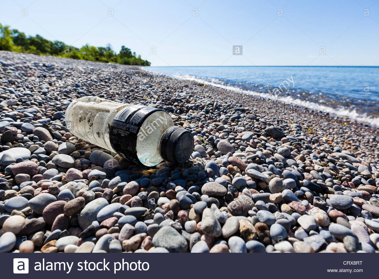 Plastic bottle litter on a Lake Ontario otherwise pristine beach near Second Marsh Wildlife Area in Oshawa Ontario - Stock Image