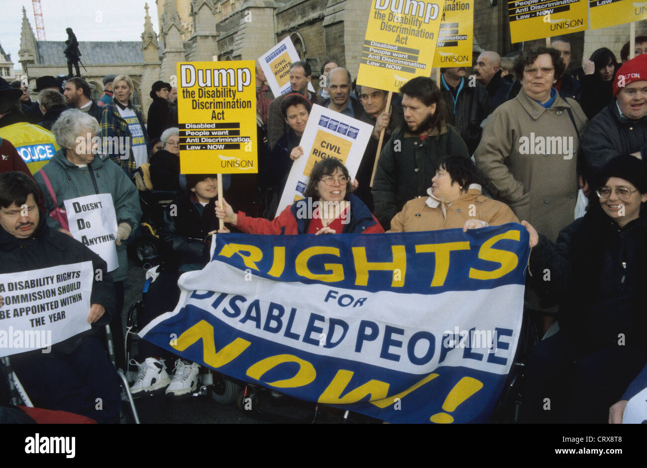 Disabled rights activists protesting at Westminster England UK - Stock Image