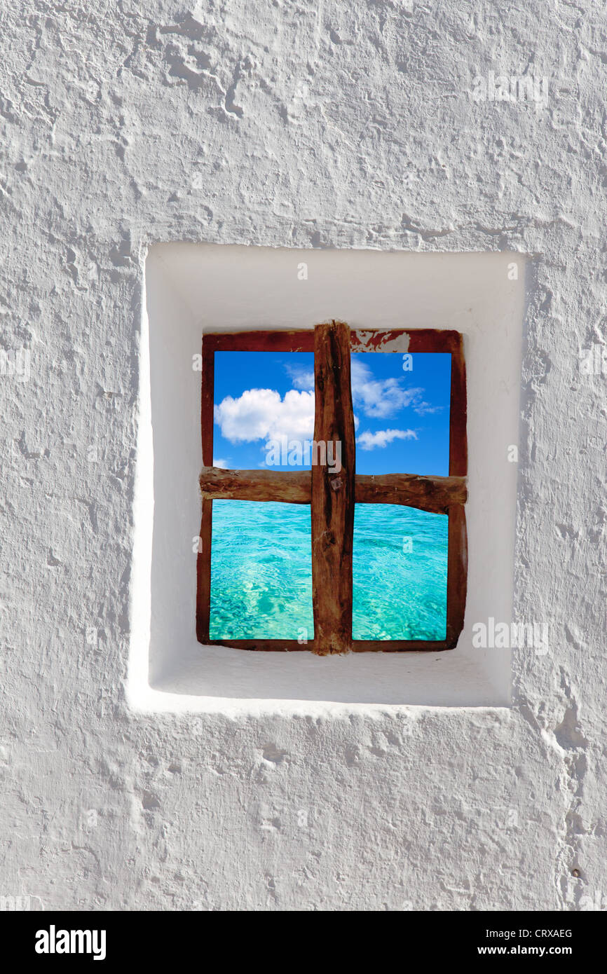 Balearic islands idyllic turquoise beach view through whitewashed house window Stock Photo