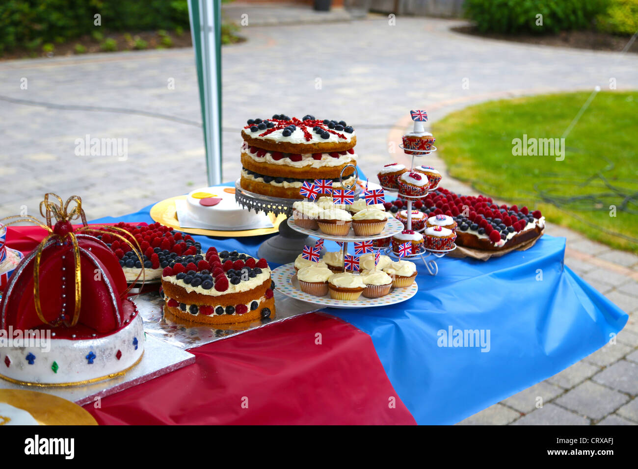 Cake Competition At A Street Party Cakes Decorated With Union Jacks - Stock Image