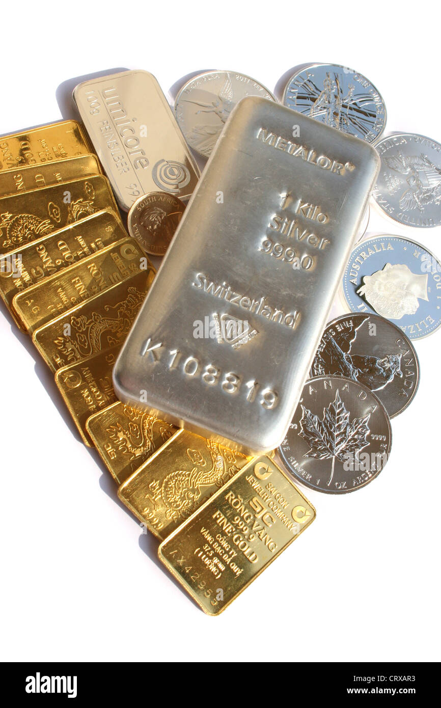 Gold bars and silver bars and coins. - Stock Image