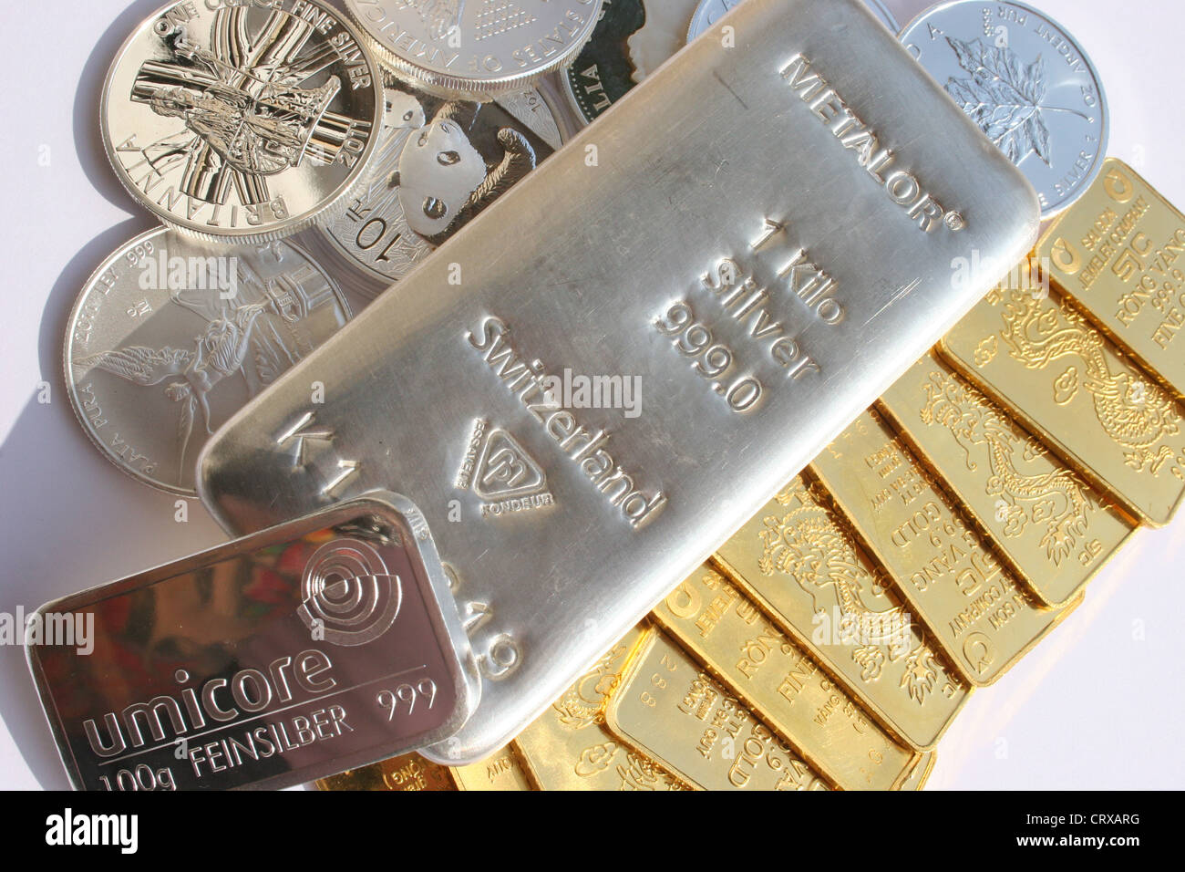 Collection of gold and silver bars and coins - Stock Image