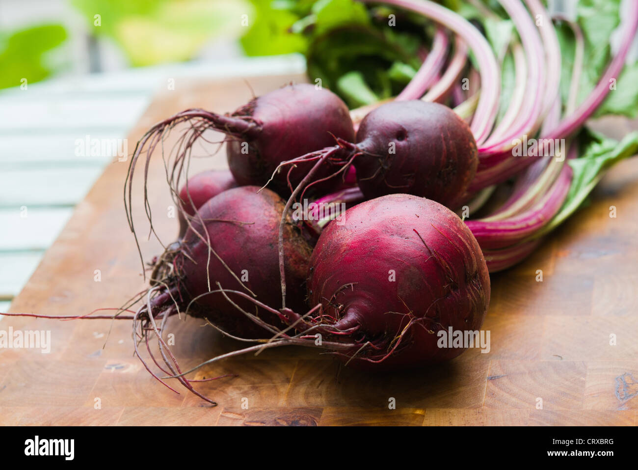Beetroots on a chopping block - Stock Image