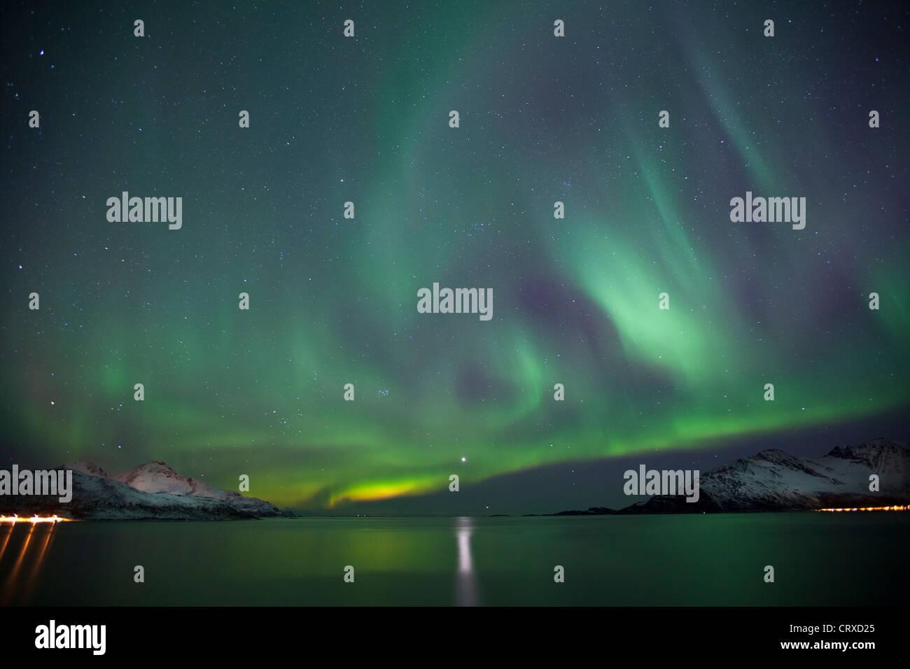 Aurora Borealis The Northern Lights fill the sky at Kvaloya in the Arctic Circle near Tromso, Northern Norway - Stock Image