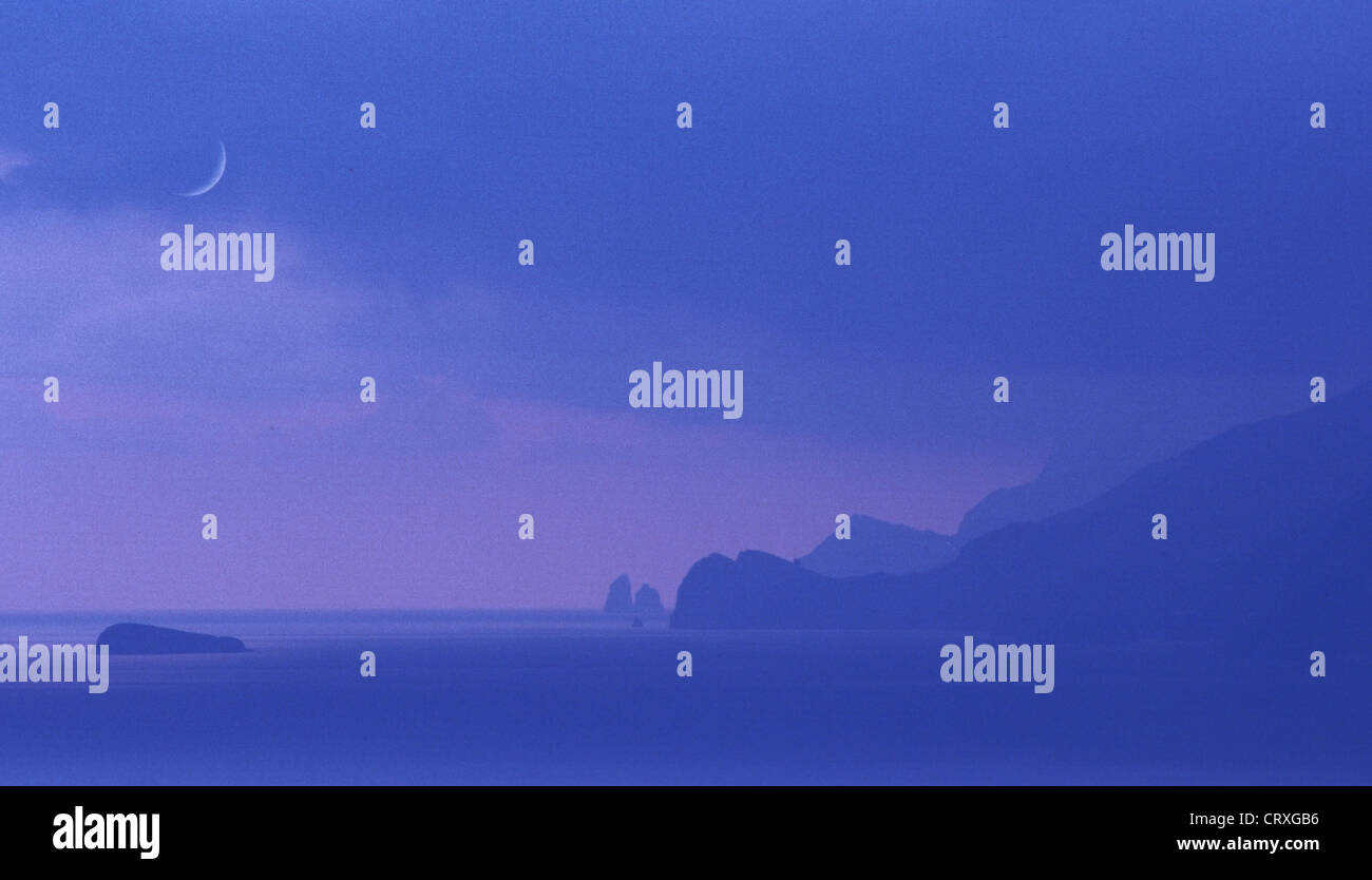 Amalfi Coast in the blue hour with crescent moon - Stock Image