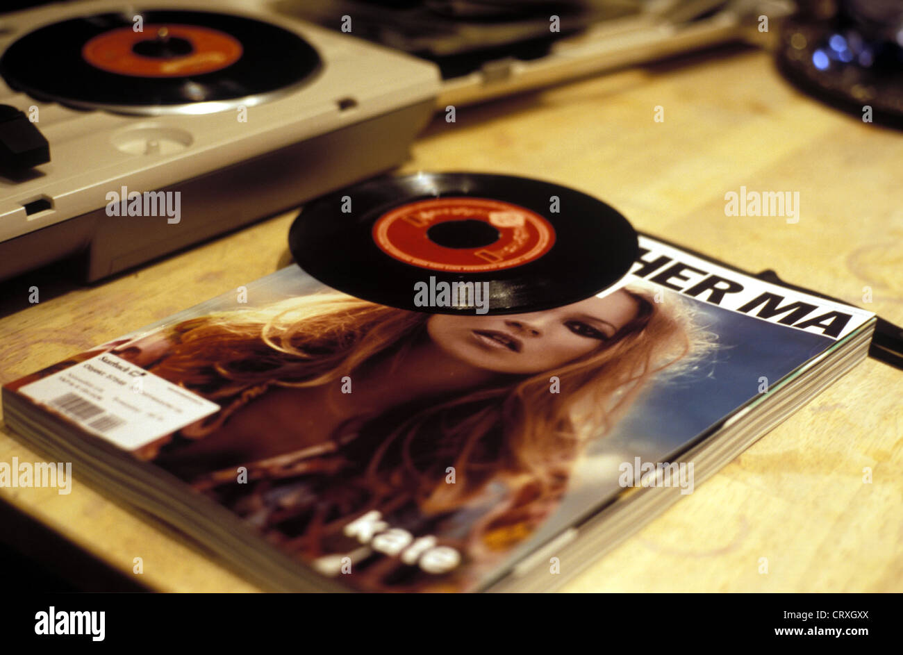 Close-up of a magazine and two singles - Stock Image