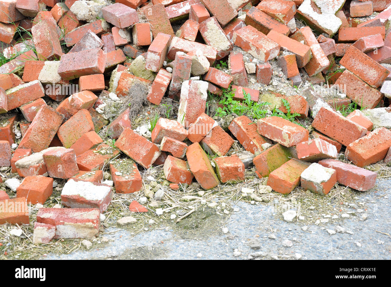 Pile of old red bricks rubble - Stock Image
