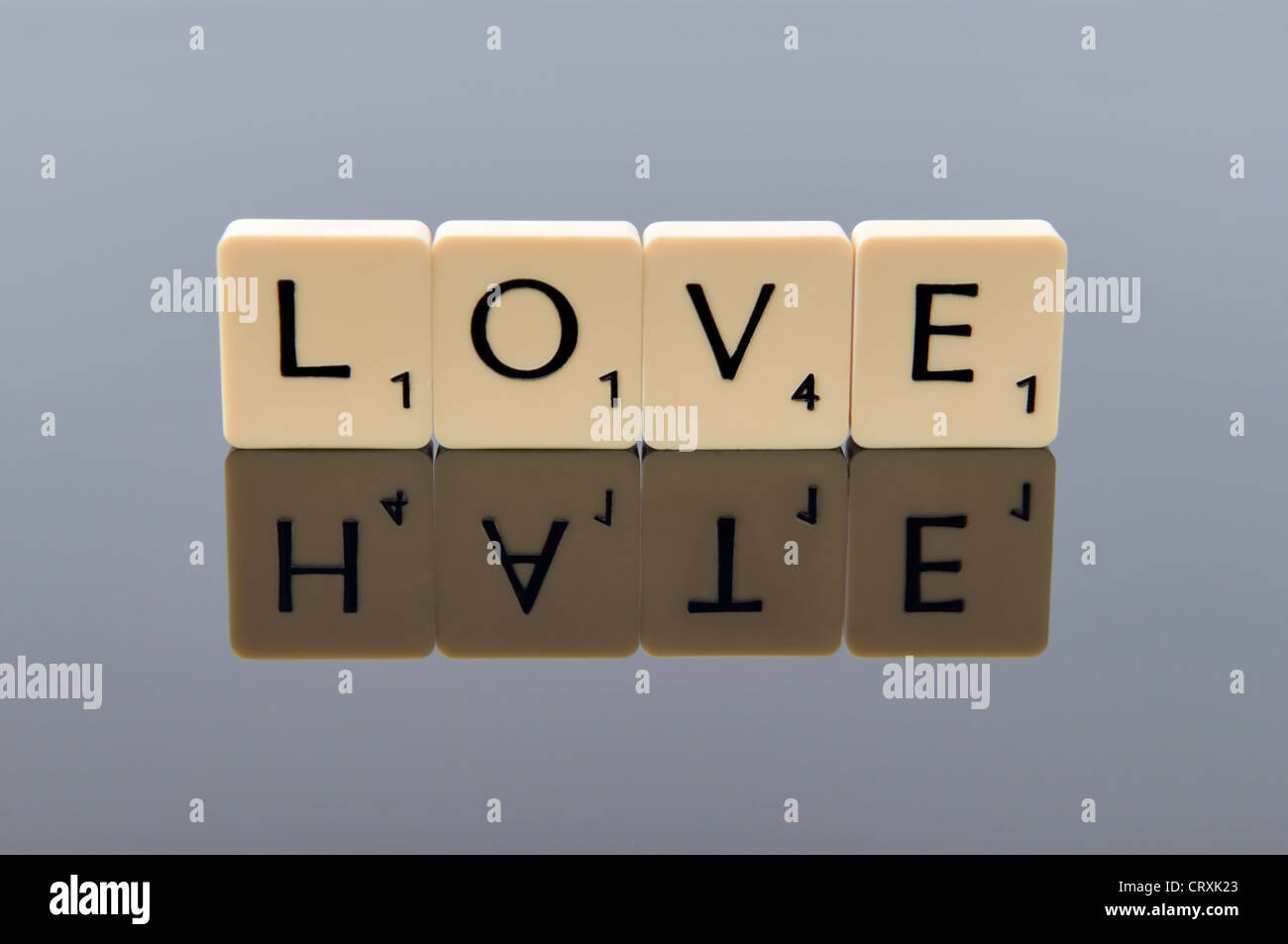 Scrabble Letters Spelling Out The Word Love With The Word As Its Reflection Concept