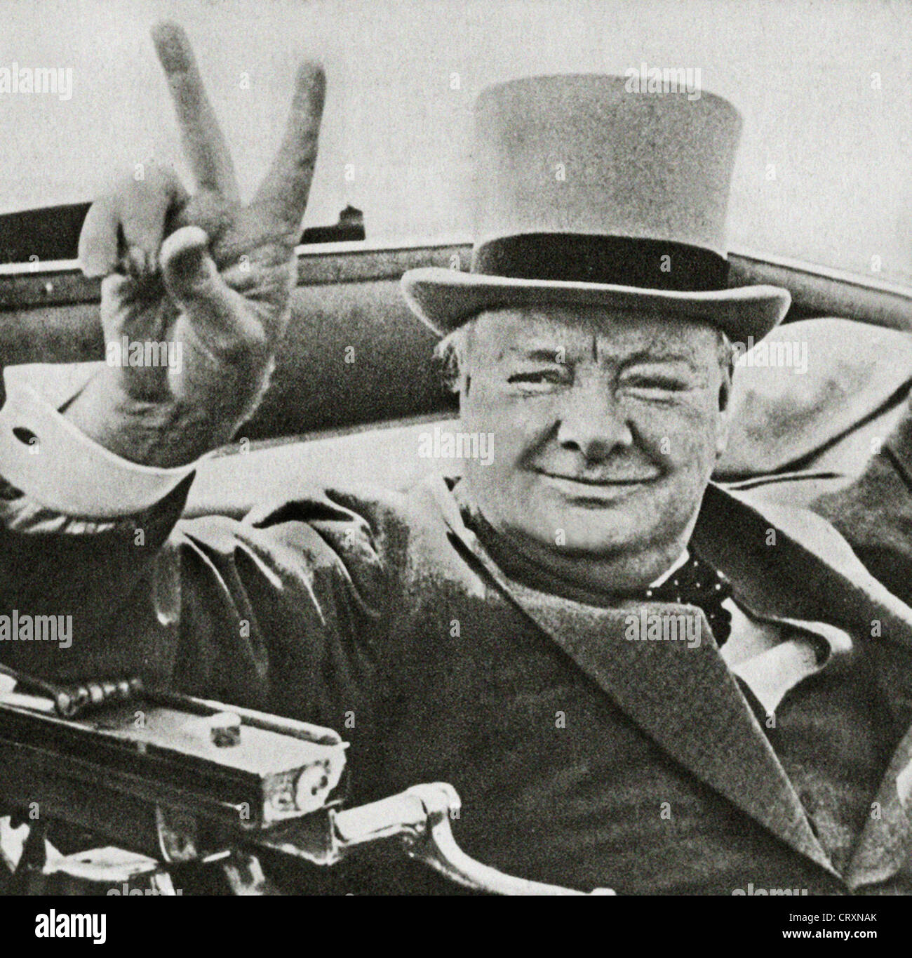 British wartime leader Winston Churchill with his famous V for victory sign. - Stock Image