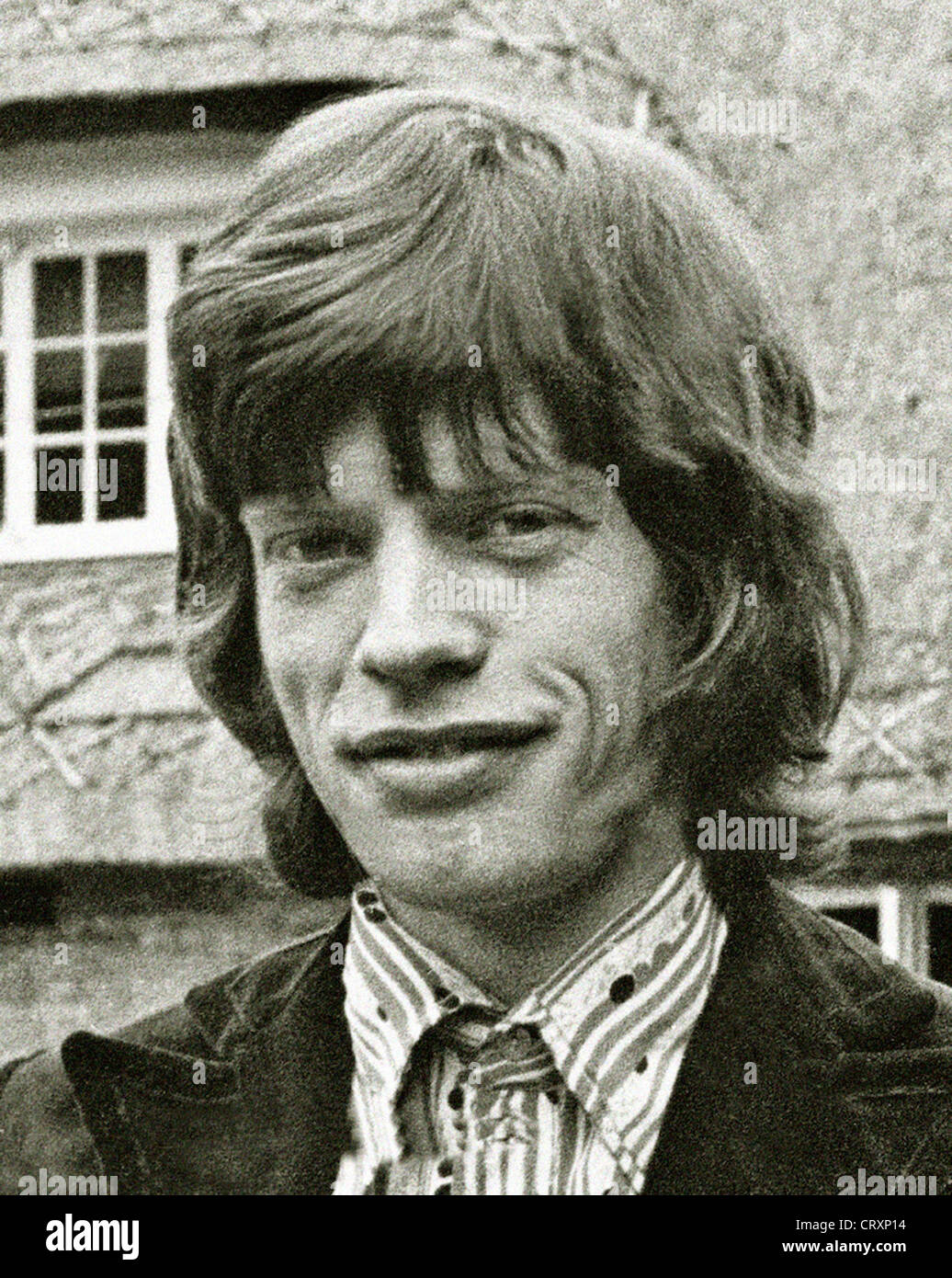 Mick Jagger exclusive image from 1967 by David Cole in the gardens at Redlands. From the archives of Press Portrait Stock Photo