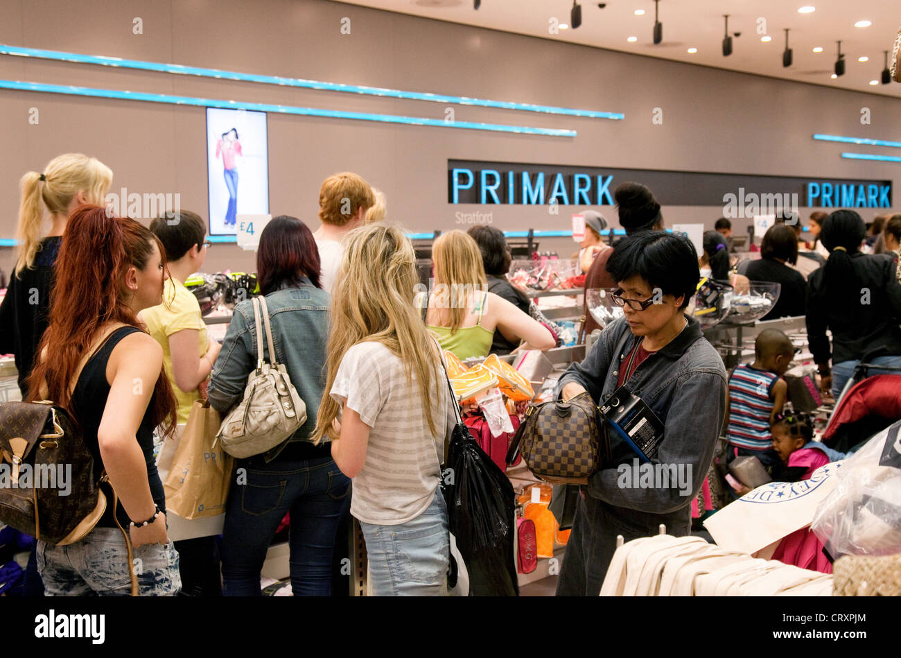 Shoppers in the Primark store, Westfield Shopping Centre Stratford London UK - Stock Image
