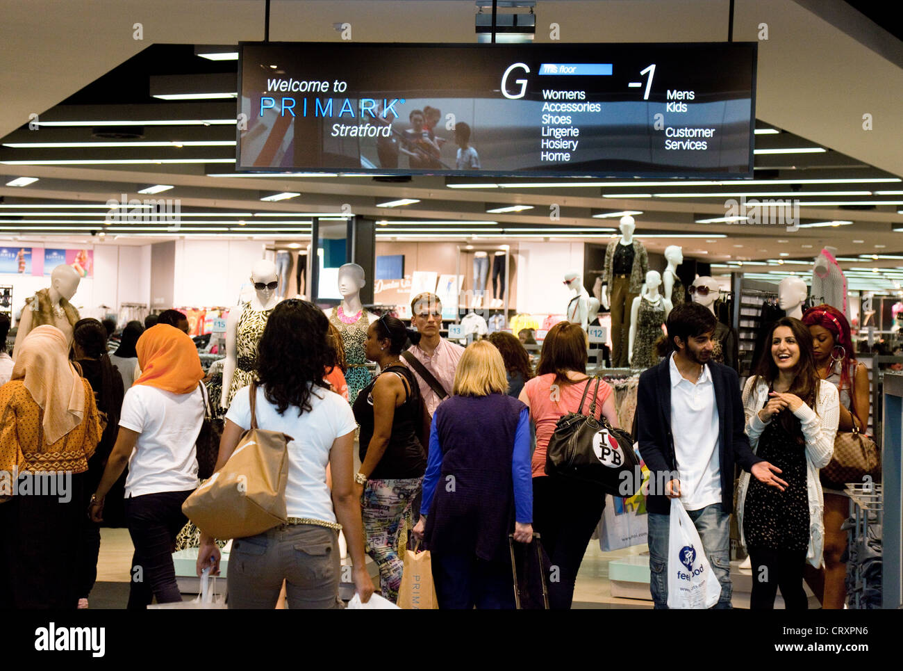Shoppers outside the Primark store, westfield shopping centre mall, Stratford London UK - Stock Image
