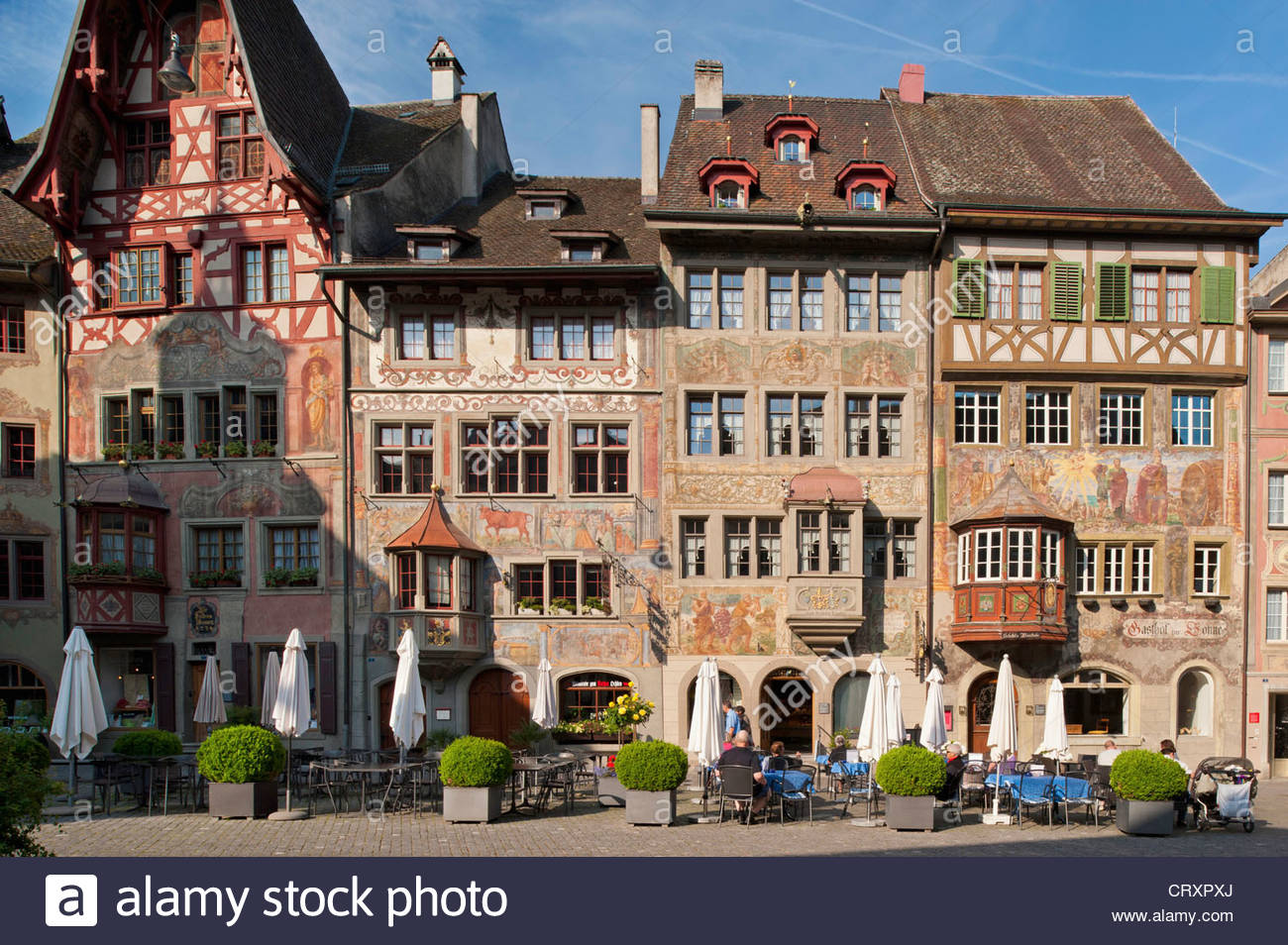 Switzerland, Stein am Rhein, People on pavement cafe and  historic houses - Stock Image