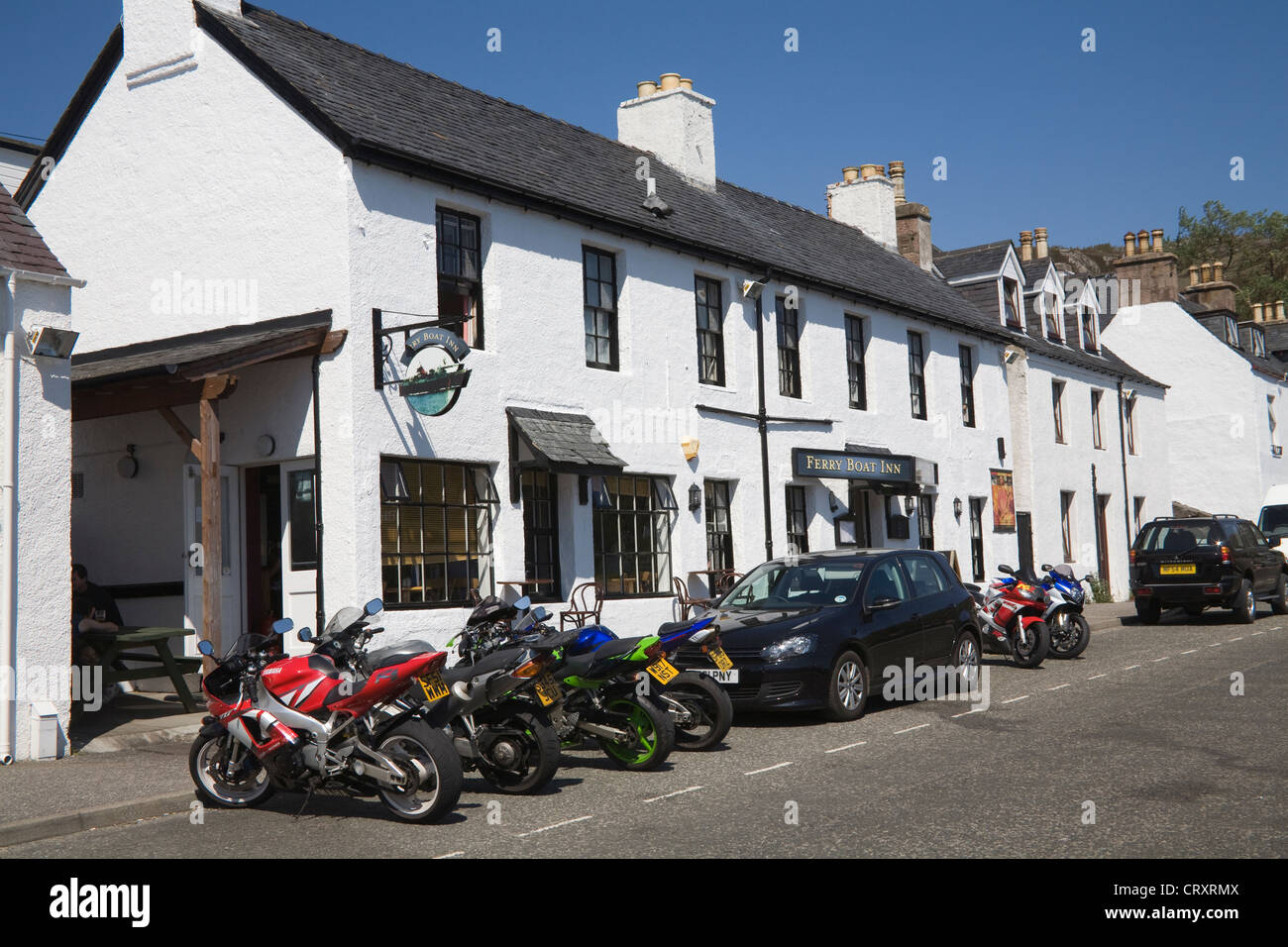 Ullapool Ross and Cromarty Scotland UK Motorbikes and cars parked outside the popular Ferry Boat Inn on a lovely - Stock Image