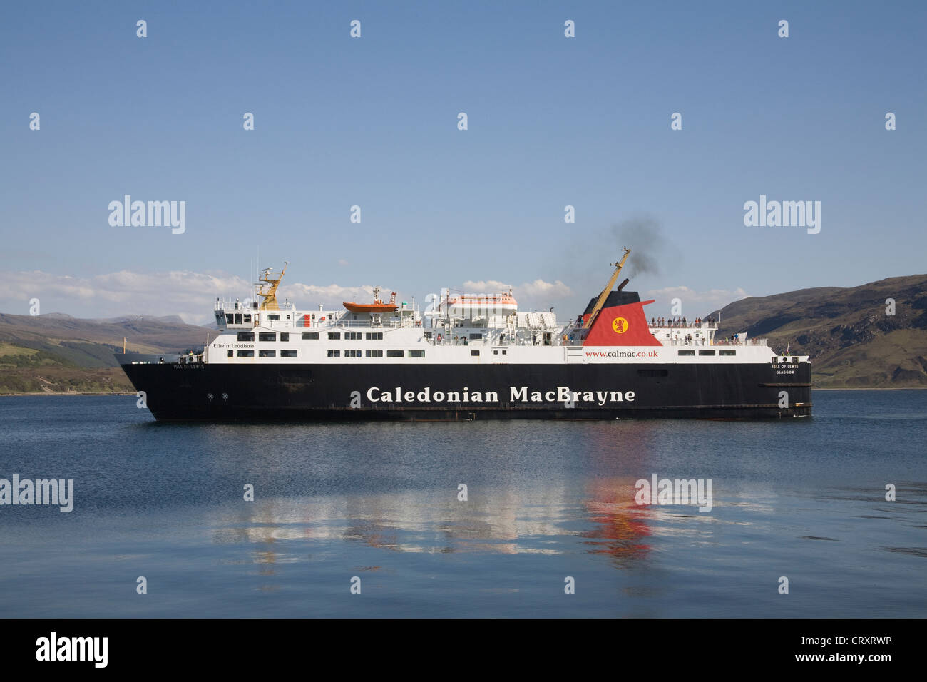 Ullapool Ross and Cromarty Scotland May Calmac ferry from Isle of Lewis on Loch Broom entering harbour of small - Stock Image