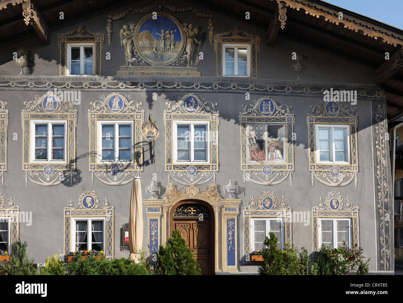 Germany, Bavaria, Garmisch-Partenkirchen, Painted windows of Husar Inn - Stock Image