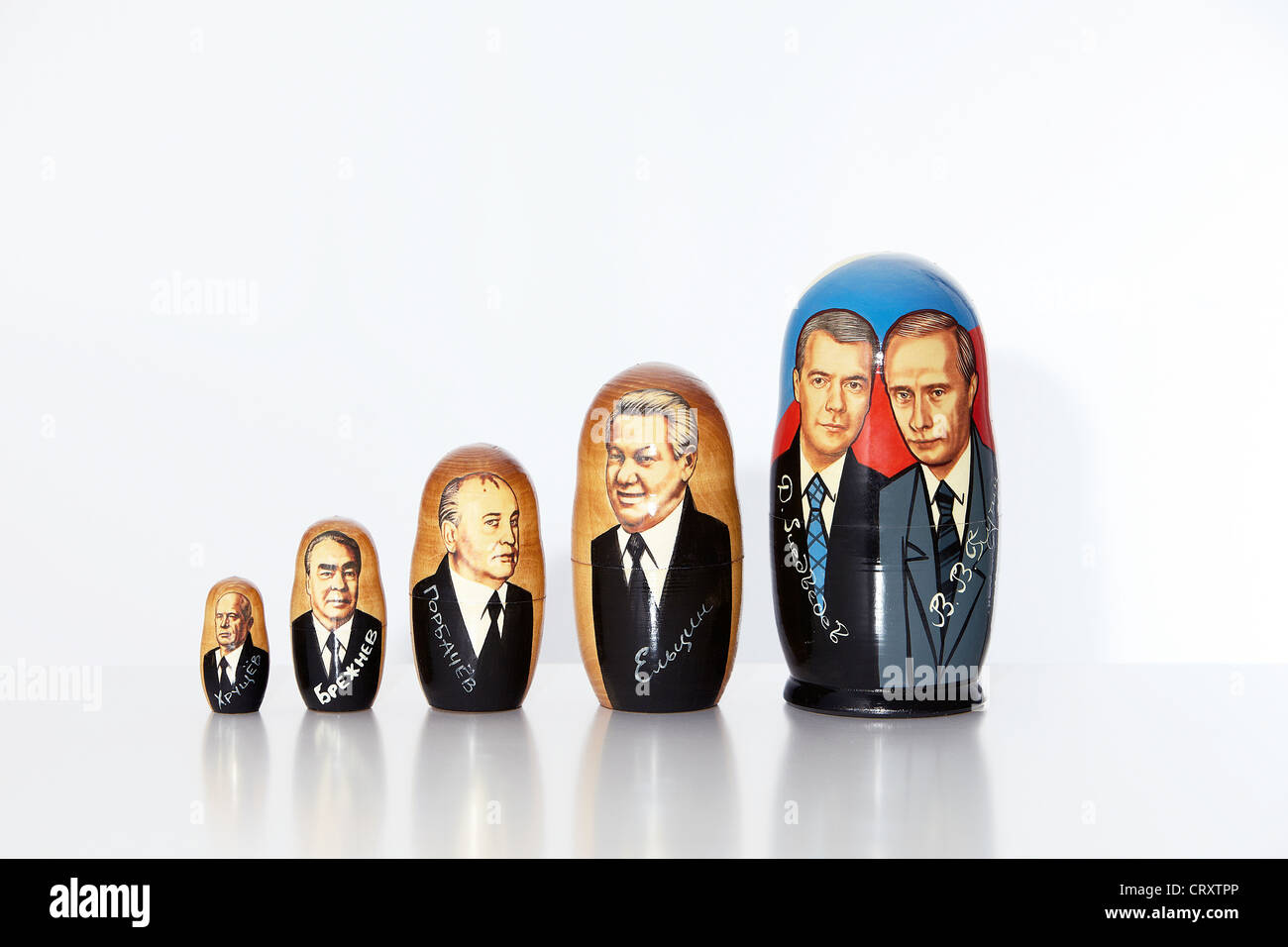Matryoshka showing pictures of Russian Presidents - Stock Image