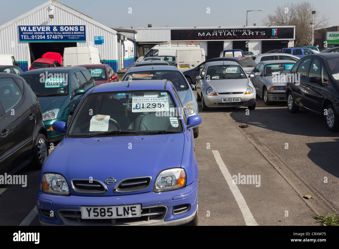 Small open air secondhand car sales site on Albert Road, Farnworth. - Stock Image