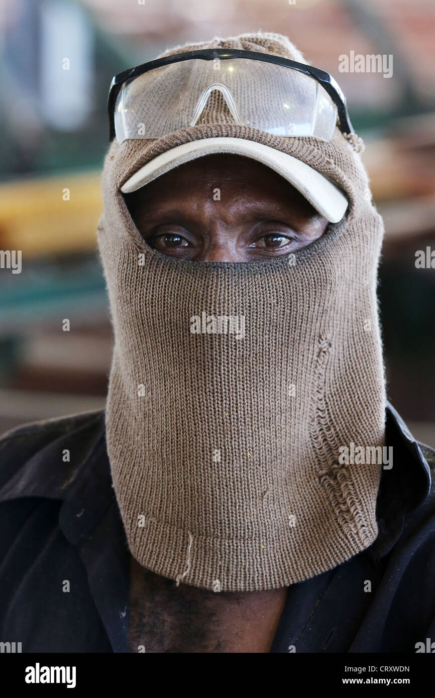 Worker in the sawmill, wood processing company Santi Forestry, Madang Province, Papua New Guinea - Stock Image