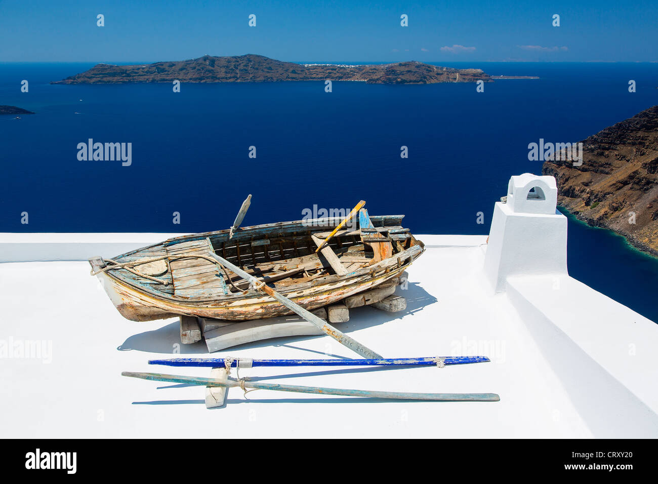Santorini, Weathered wooden boat on balcony Stock Photo