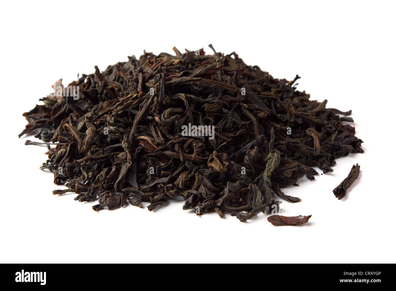 Heap of dred black tea leave isolated on white - Stock Image
